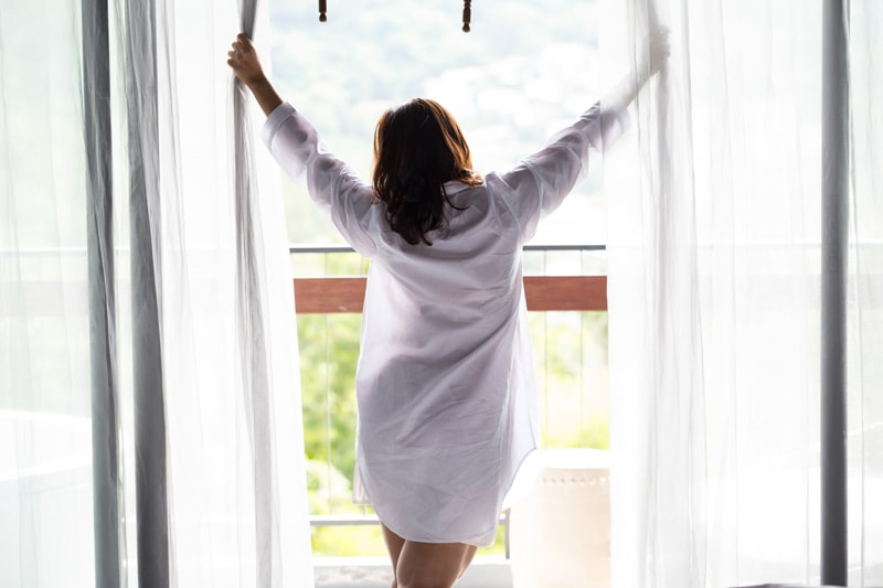 Woman-Opening-Curtains